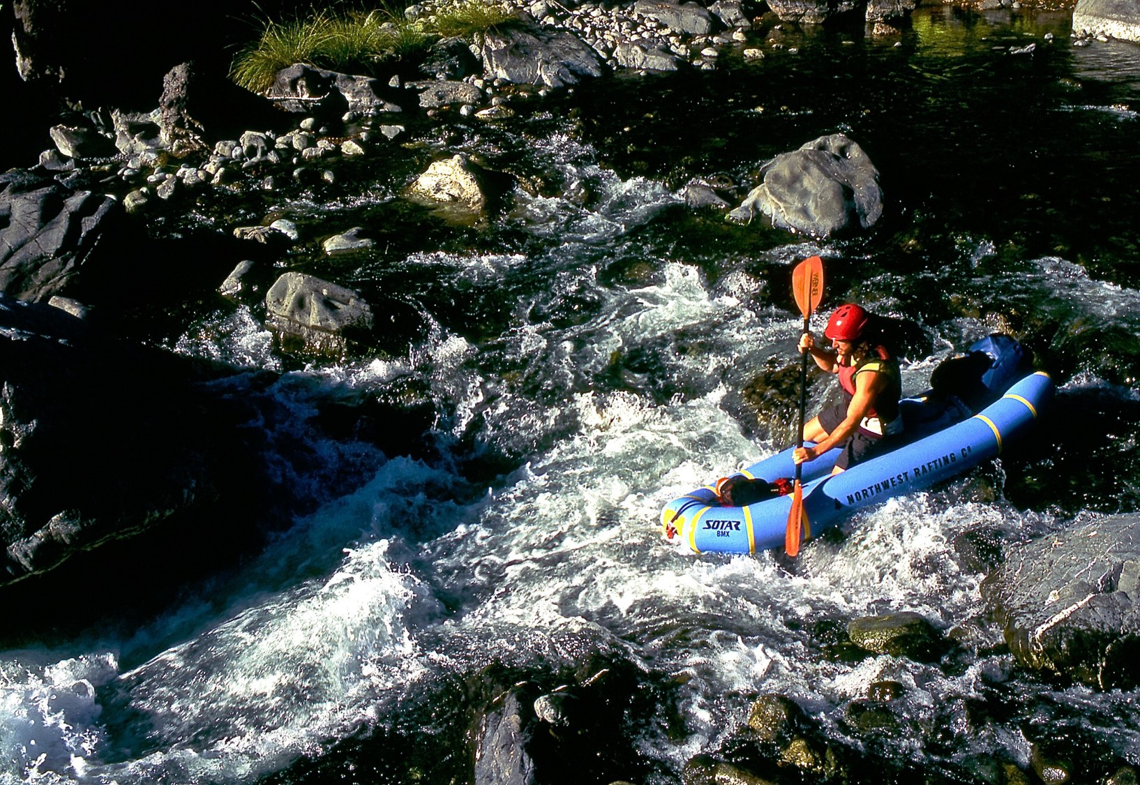 A photo of a kayaker on the Chetco River - Rogue River-Siskiyou National Forest.