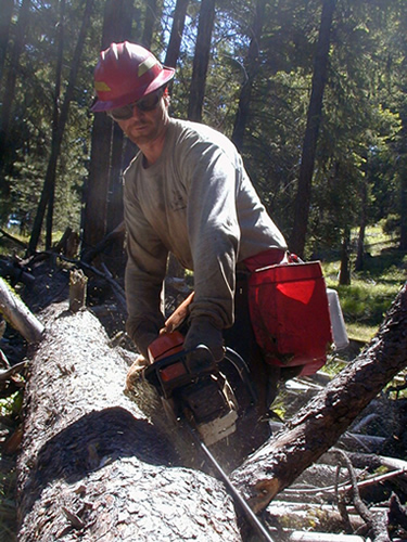 A local forestry company crew member hand piling on the Lookout Mountain Ranger District of the Ochoco National Forest.