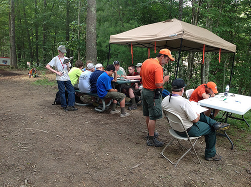 Boy Scouts work on pulp and paper merit badge at the Forest Service exhibit.