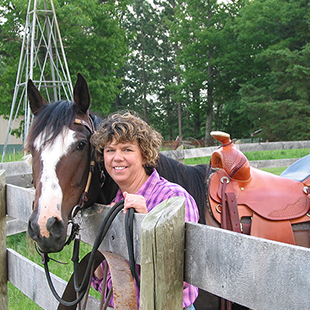 A picture of Mary K. Rasmussen and a horse