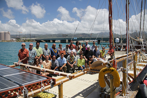 Representatives from multiple conservation groups aboard the Hokule'a, a double-hulled voyaging canoe.