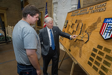 Daniel Stevenson, carpentry student of the Collbran Job Corps Center shows Tom Tidwell, Chief, U.S. Forest Service a map he created of the 28 Job Corps Centers.