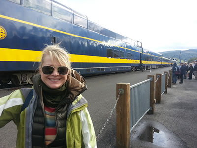 A photo of Katie Armstrong waiting to board the Glacier Discovery Train.