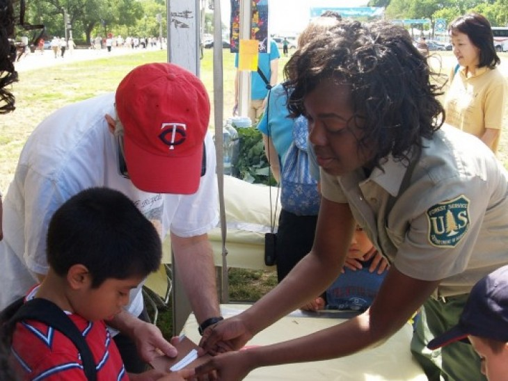 Michaela Hall, a workforce program specialist for the U.S. Forest Service, leads an educational activity to explain how important the sun is to plant life during a National Get Outdoors Day Event held in Washington, D.C.