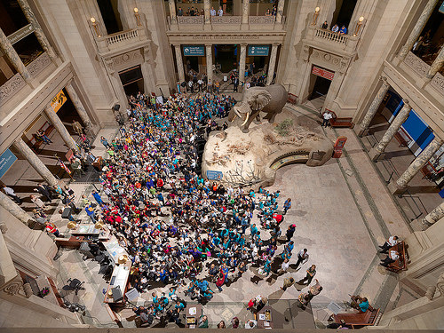 Young people are made honorary junior paleontologists in the rotunda of the Smithsonian Institution's National Museum of Natural History.