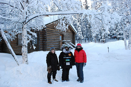 Bureau of Land Management employee Marnie Graham, musher Heidi Sutter, and U.S. Forest Service employee Carol Teitzel