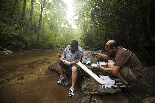 biologist Jeff Humphries and field technician Michael Sisson, both with the North Carolina Wildlife Resources Commission, monitor hellbender populations.