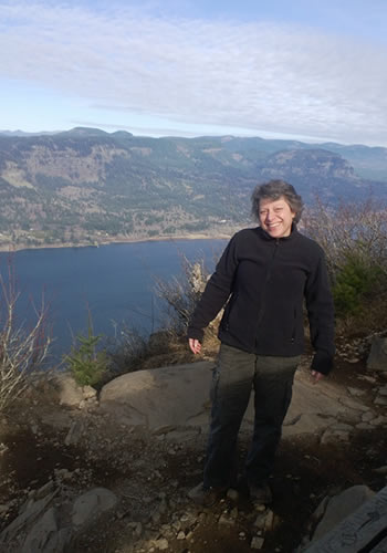 Nancy Lankford smiles after stopping on the Angel's Rest Trail in the Columbia River Gorge National Scenic Area. (Photo courtesy of the U.S. Forest Service)