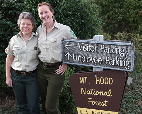 Nancy Lankford poses with co-worker and fellow cancer survivor Ann Renninge at the Mt. Hood National Forest Headquarters. (Photo courtesy of the U.S. Forest Service)