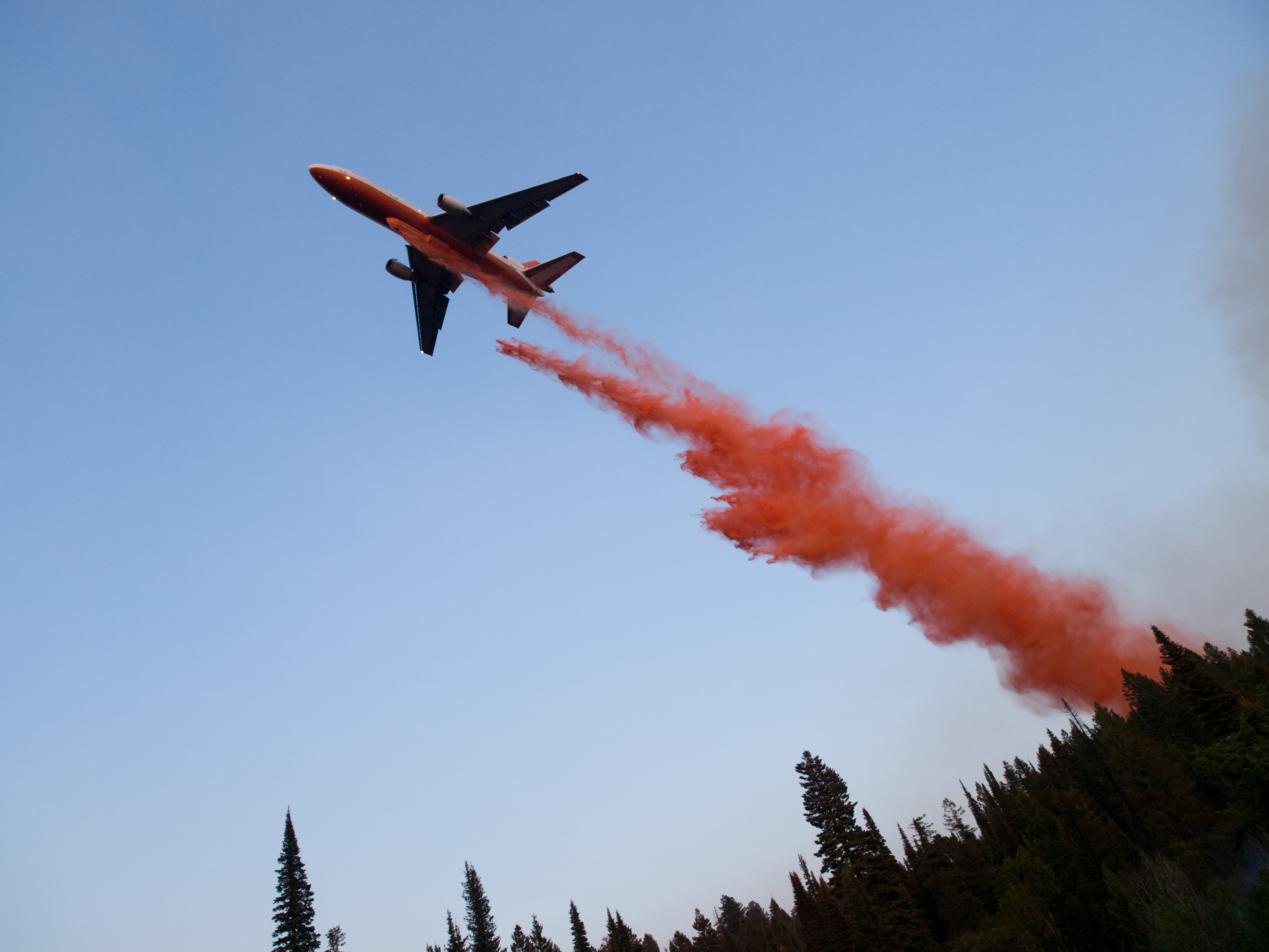 An Airtanker drops fire retardant on a wildfire. (USFS Photo)