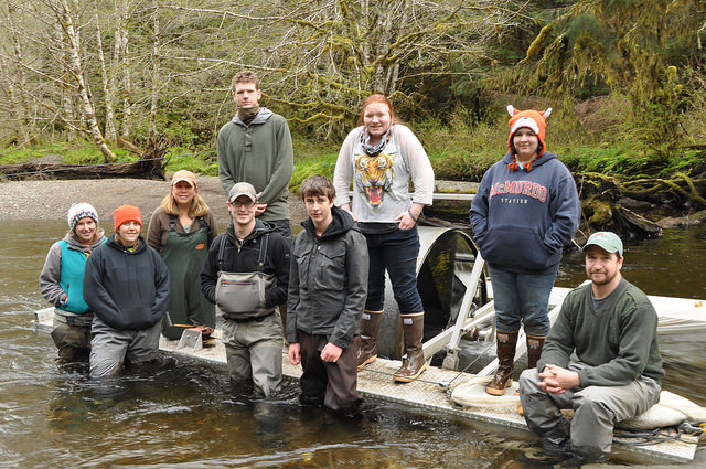 The Twelvemile Creek restoration monitoring crew and Fish Tech Boot Camp students and instructors pose for a photo in front of a screw trap, which captures coho and steelhead smolt that our migrating out to the ocean.