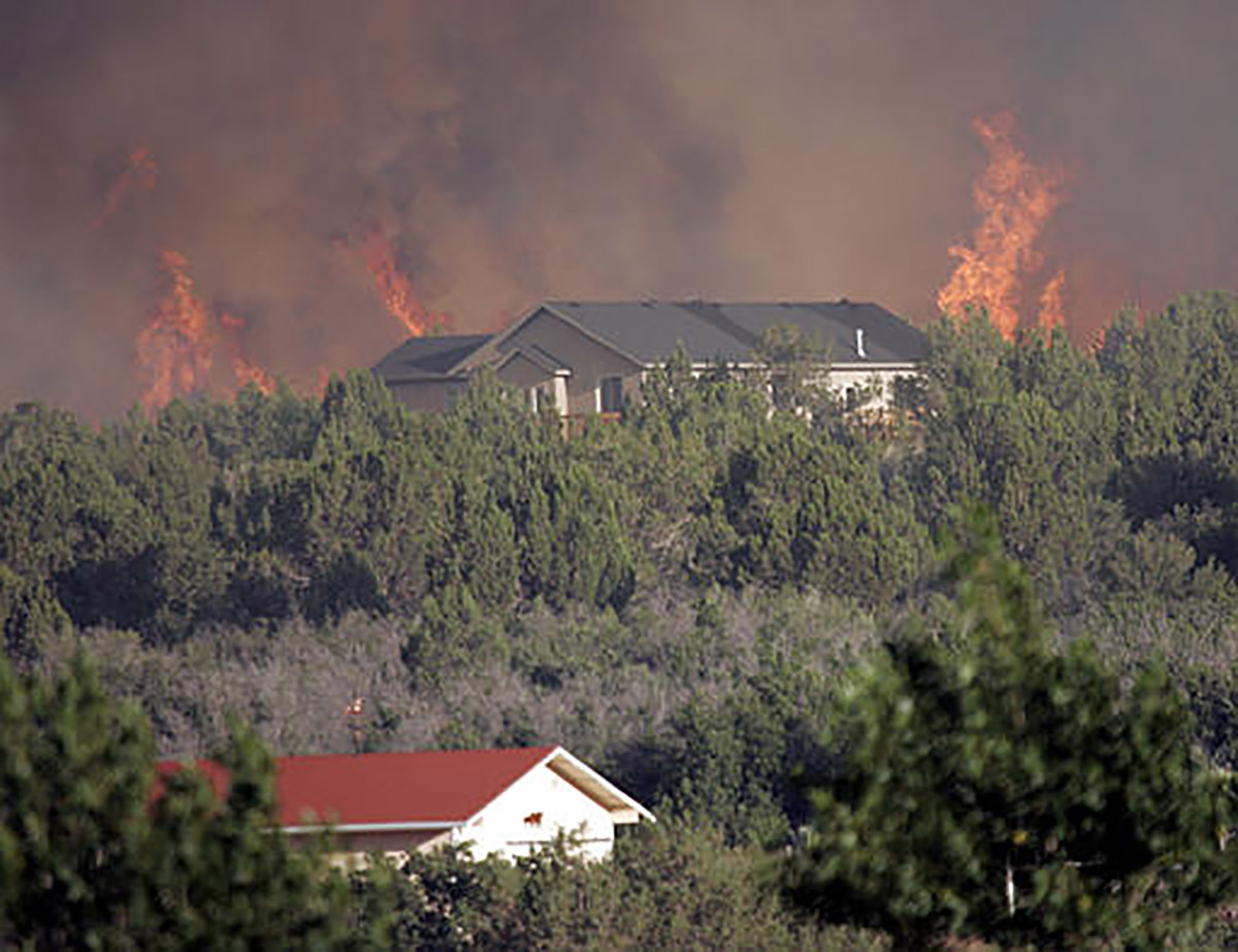 Wildland fires burn intensely and creating a defensible space around your home can be the difference between a close call and destruction. (U.S. Forest Service photo)