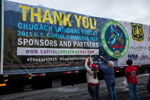 Last minute finishing touches are performed on the banner that will wrap the truck trailer designated to take the 2015 National Capitol Christmas Tree on its journey across America.