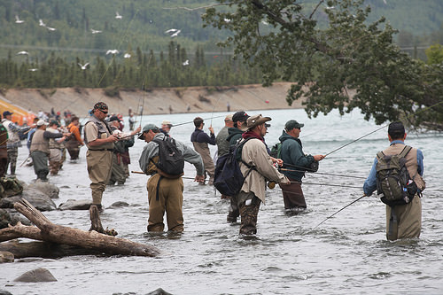 A photo of enthusiasts fishing on a backwater channel of the Kenai River just downstream of the Kenai/Russian Rivers confluence.