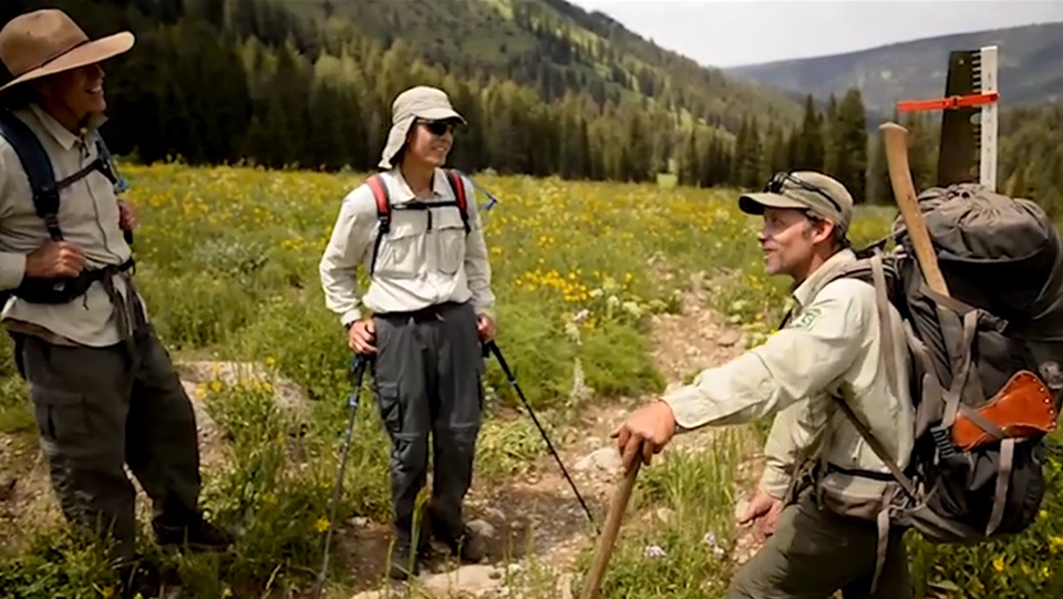 A photo of Chad Grossenburg, talks with recreation visitors hiking trails in the Jedediah Smith Wilderness.