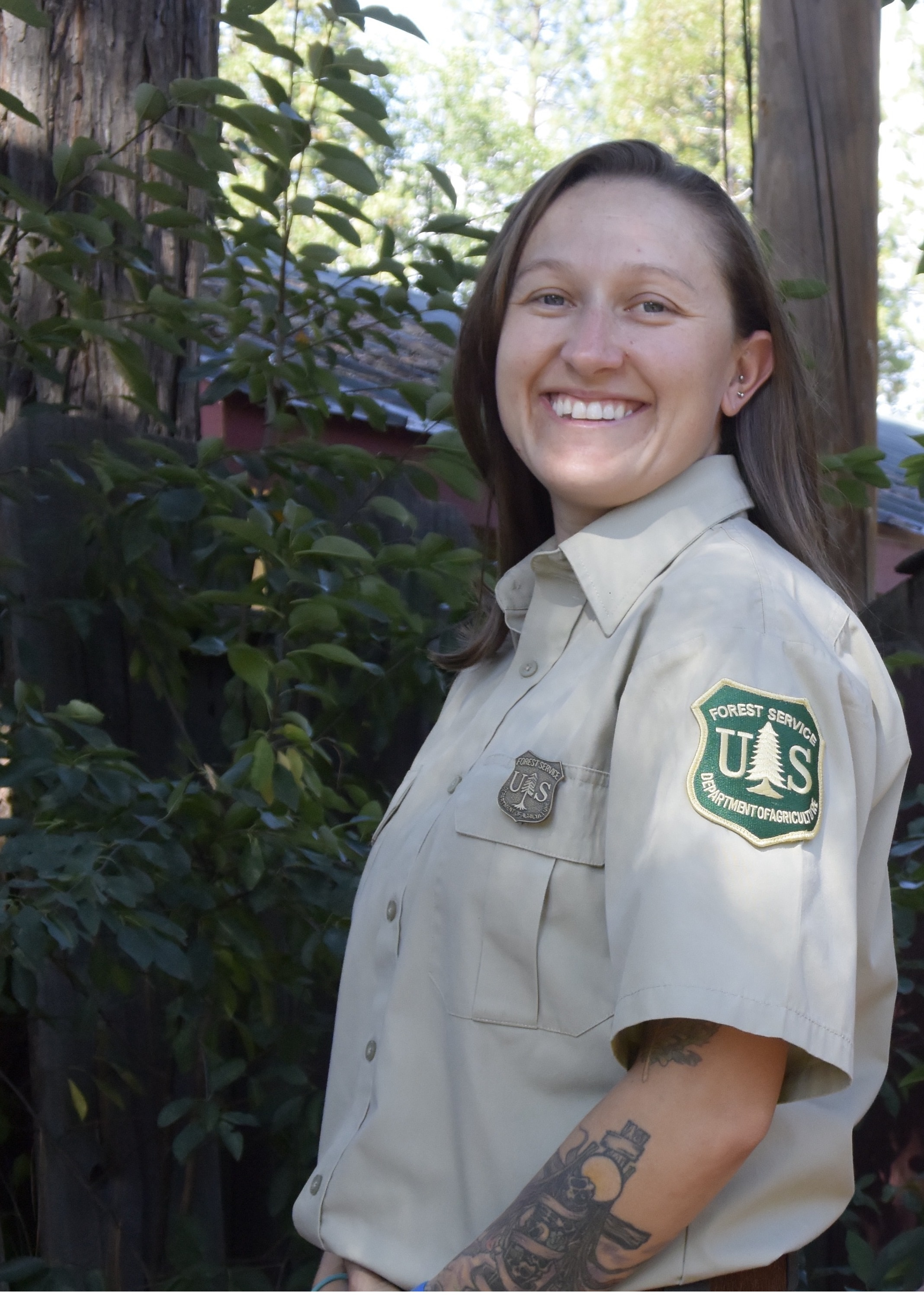 A photo of Sara Billings wearing her Forest Service uniform
