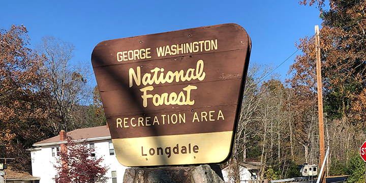 An image of the Forest Service sign for the Longdale recreation area.