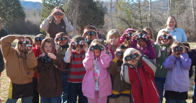 A photo of a group of kids with binoculars