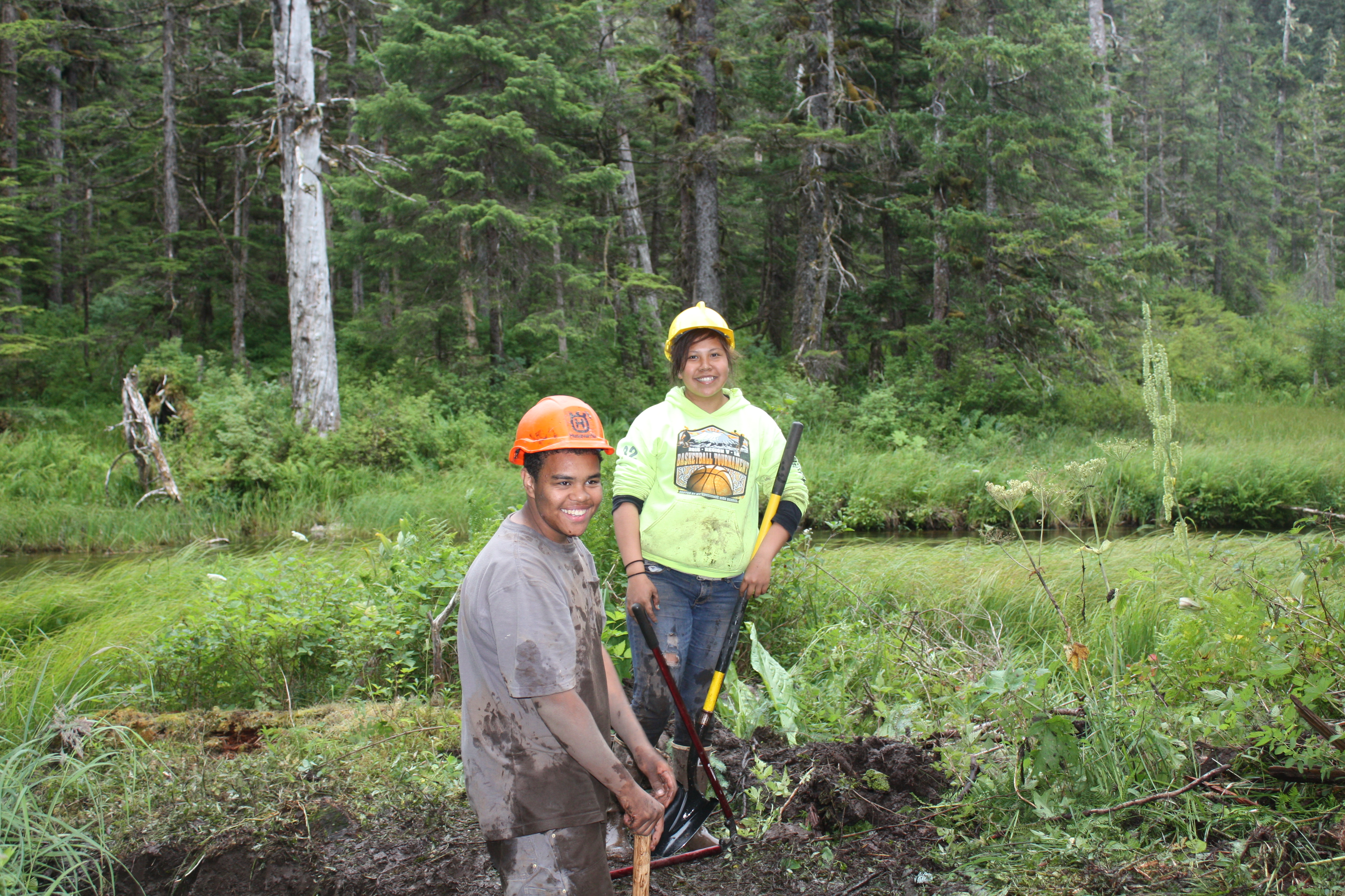 Angoon Youth Conservation Corps members Kevin Mitchell and Desiree Jamestown get their hands dirty doing trail work on Admiralty National Monument in the Tongass National Forest during their 8-week, 2016 season.