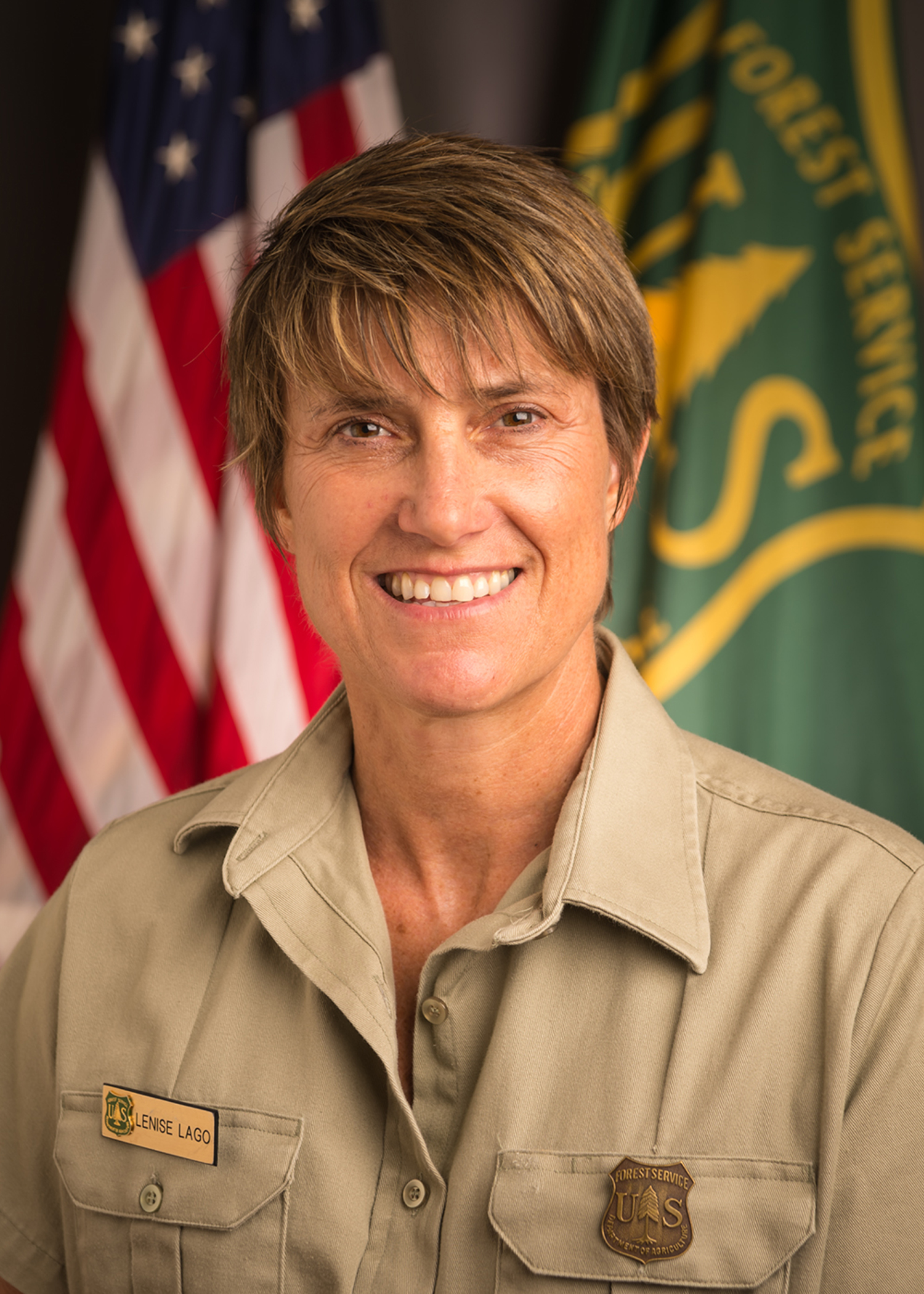 A picture of Lenise Lago in Forest Service uniform.