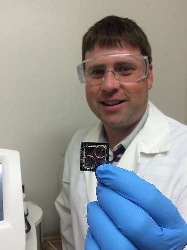 Forest Service Research Botanist Jonathan Palmer holds a DNA sequencing chip. Photo credit: US Forest Service