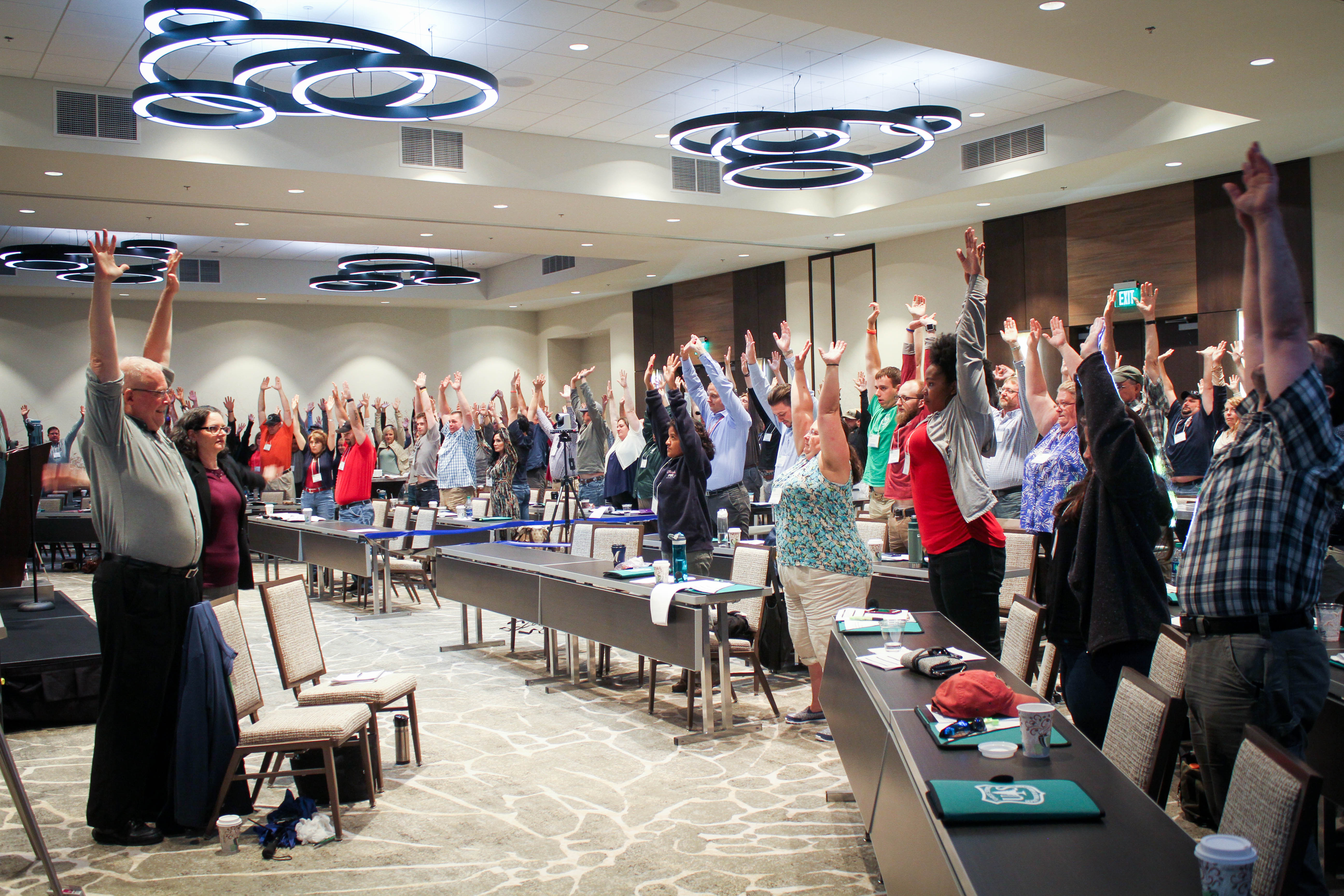 Photo: New Employees do stretch exercises as NNEO