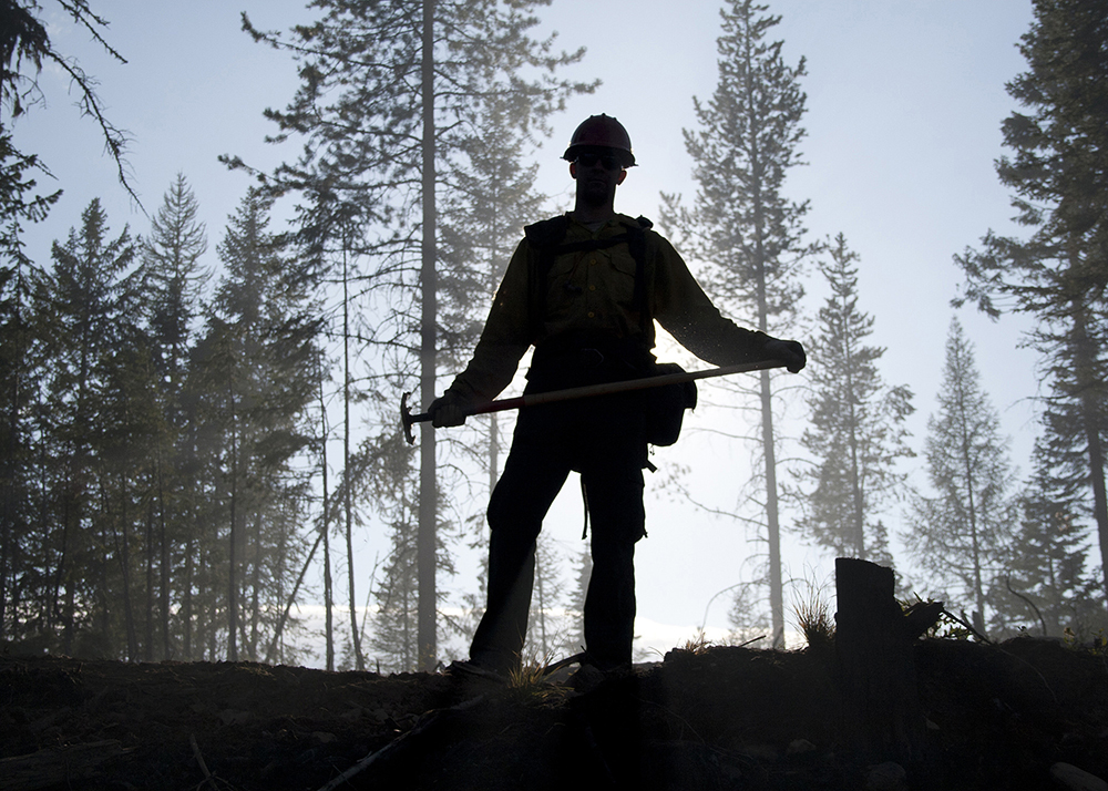 A photo of a silhouetted fire fighter.
