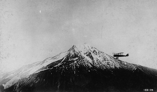 A photo of an Airplane fire patrol circling Mt. Jefferson in the Cascade Range