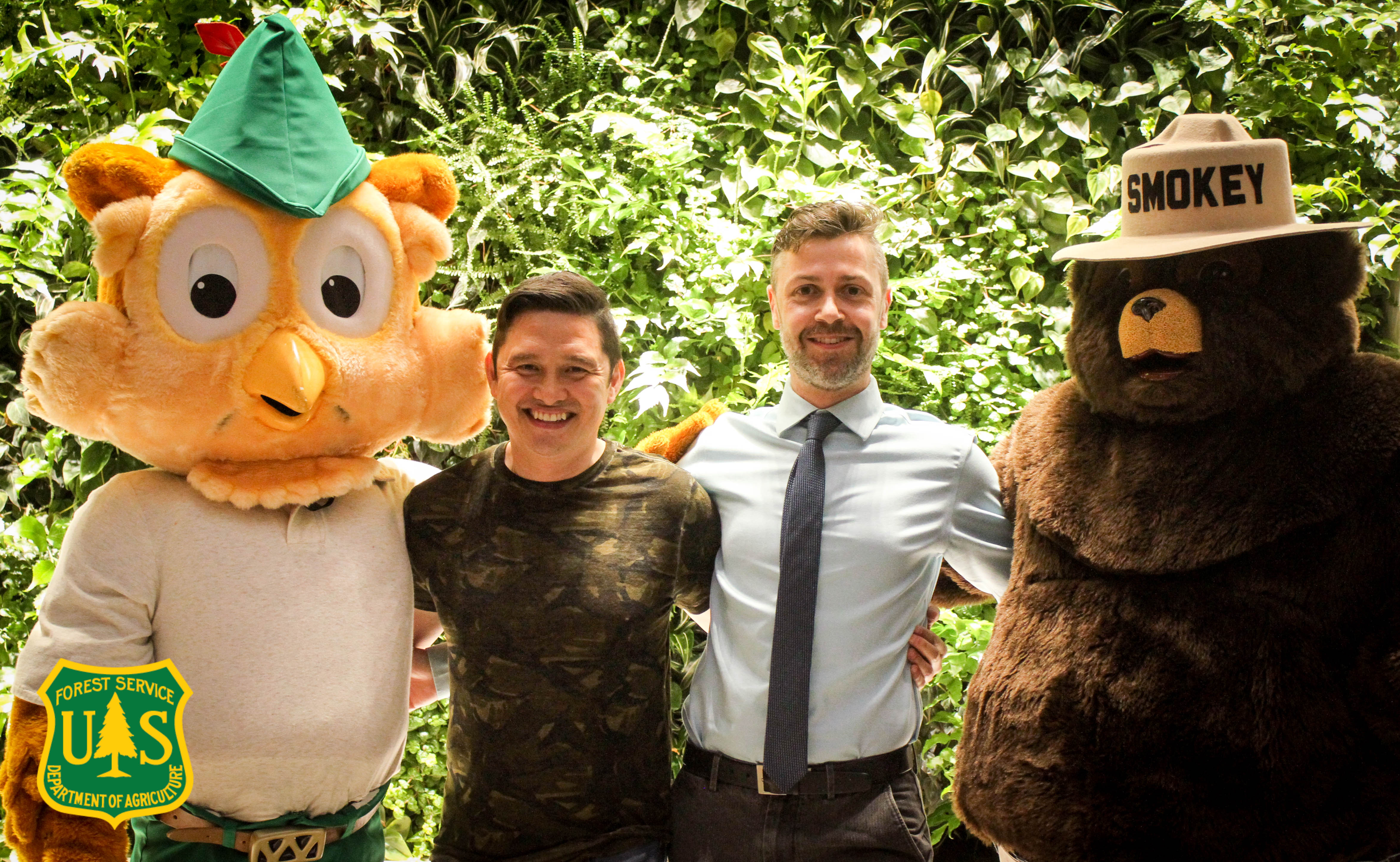 A picture of Aleksey Minchenkov (right) and Forest Service Multimedia Manager Cecilio Ricardo (left) with both Smokey Bear and Woodsy Owl.