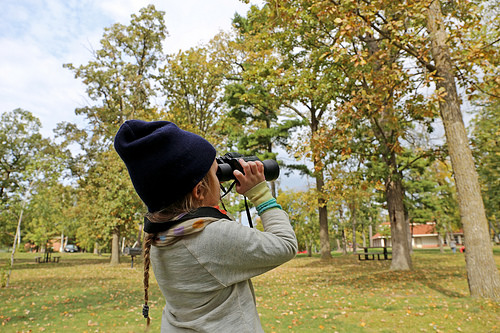A photo of a student gazing out on Bemidji Park in search of a Bald Eagle