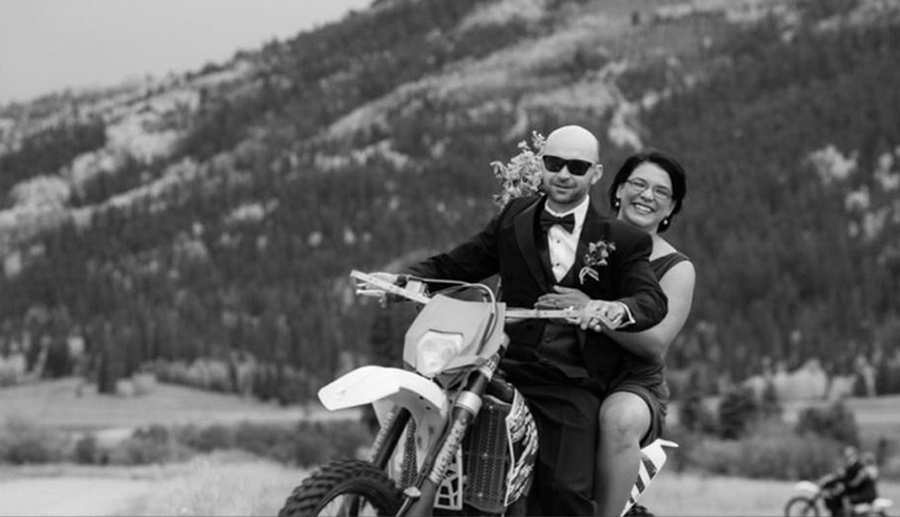 A photo of Ben and Catherine riding a motorcycle
