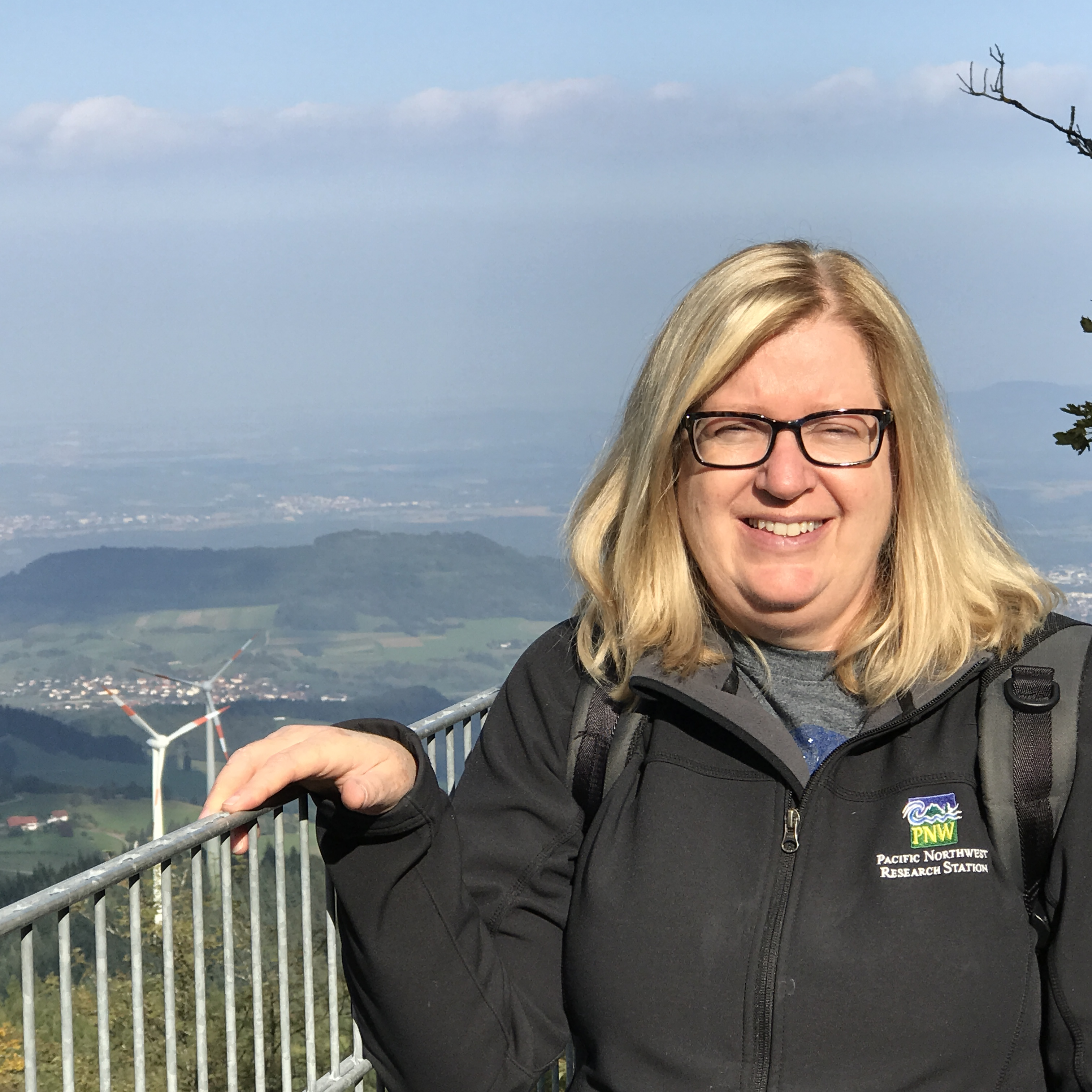 A picture of Cindy Miner with the Black Forest of Germany in the back ground.