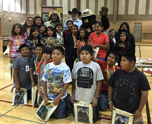 "A photo of USDA Deputy Under Secretary Arthur ""Butch"" Blazer is all smiles with a group of San Carlos Apache Reservation fourth graders"