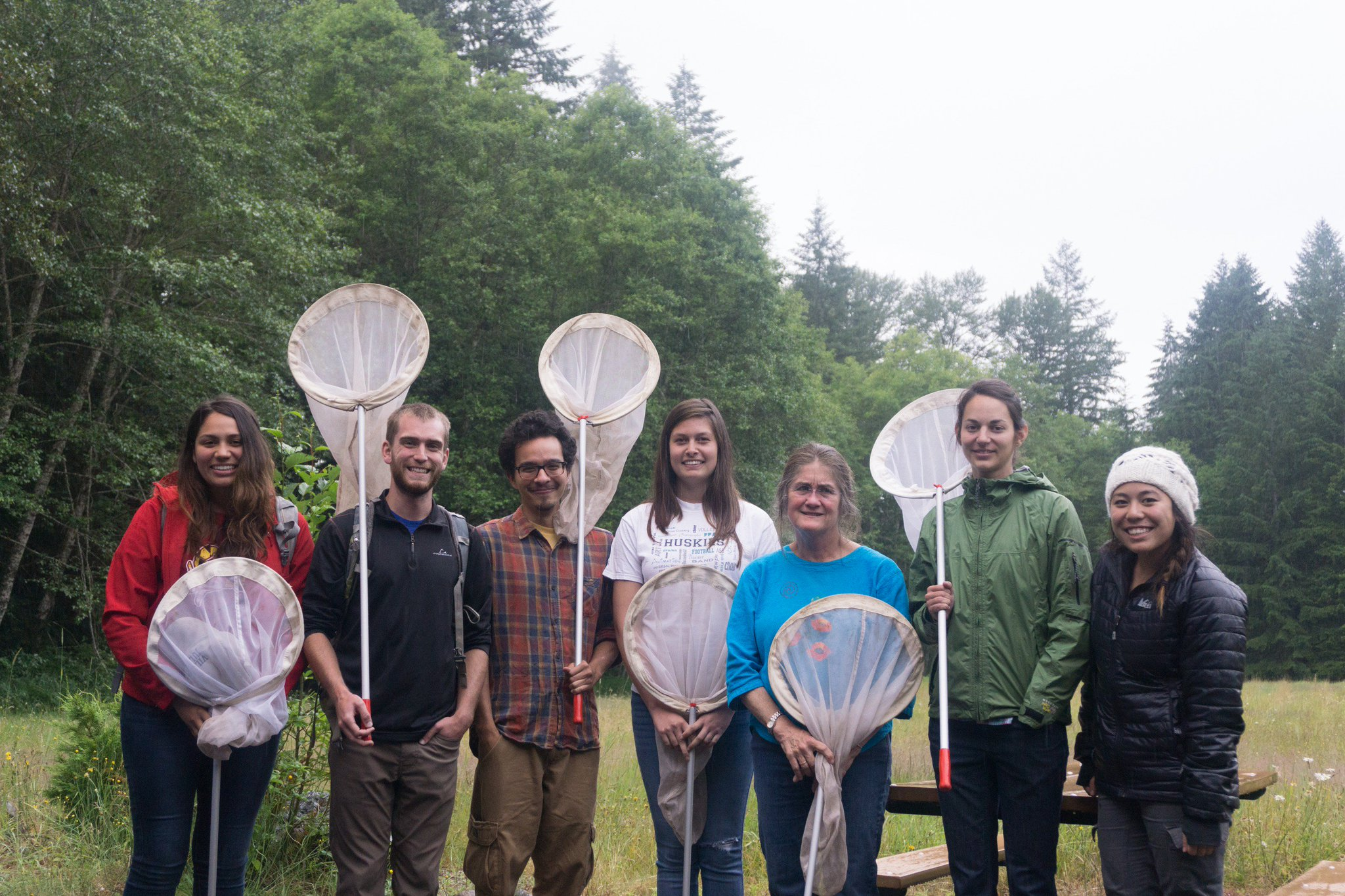 Regina Rochefort and citizen scientists pose with their butterfly nets.