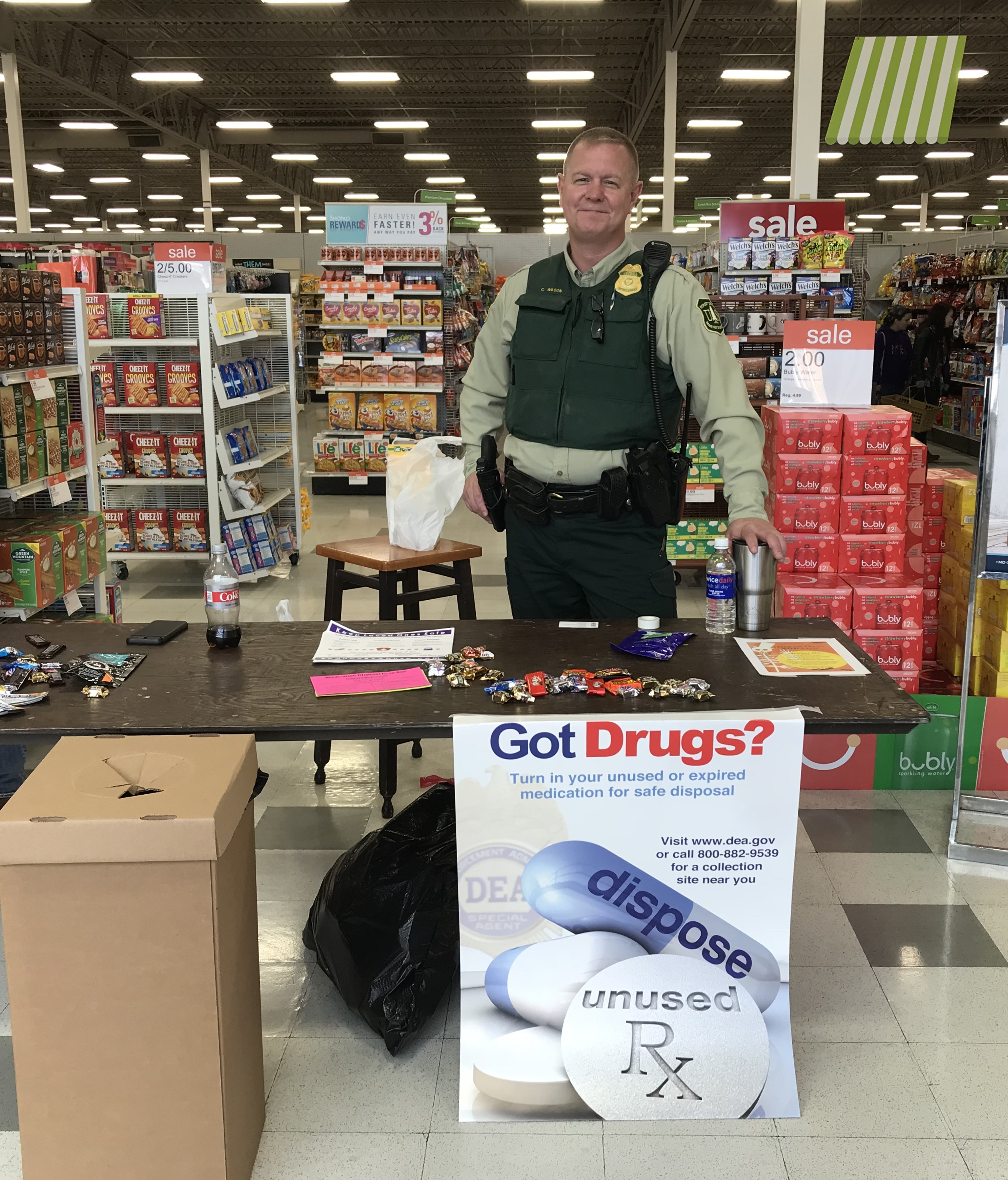 Forest Law Enforcement Officer standing in a store