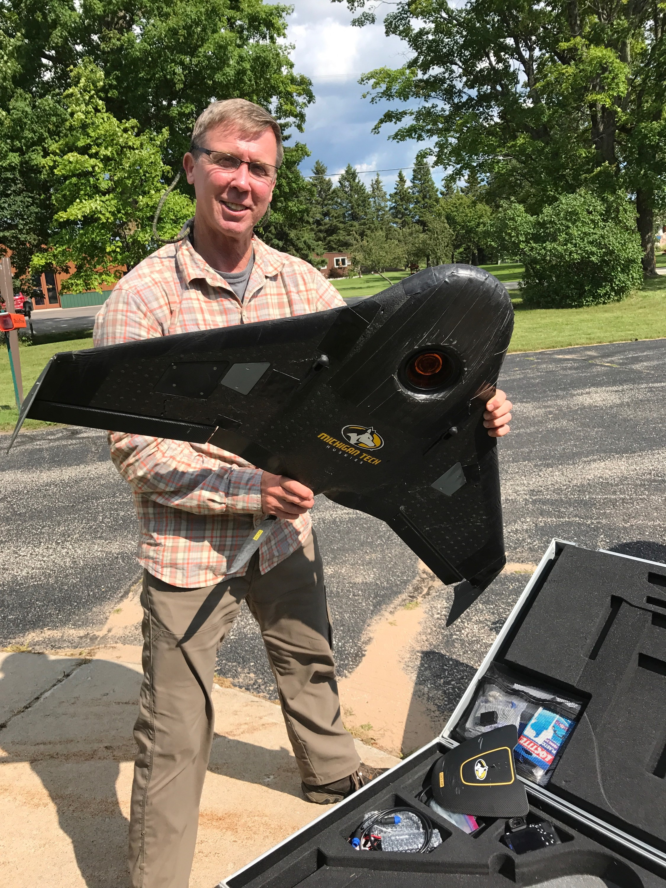 Dr. Curtis Edson, Assistant Professor of Remote Sensing and Geographic Information Systems at MTech,hold the UAV used in the drone flights over the Hiawatha National Forest.