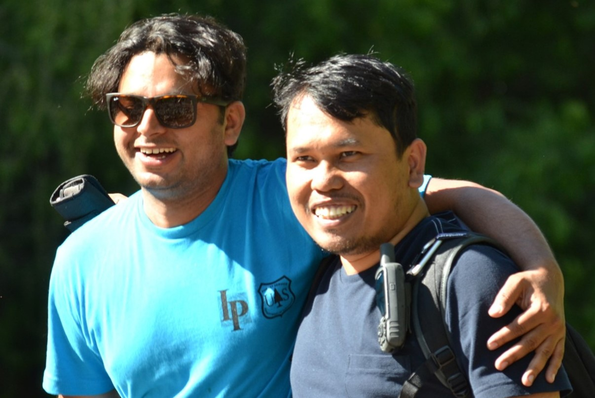 Two men from Nepal and Indonesia participate together during this month's International Seminar on Watershed Management