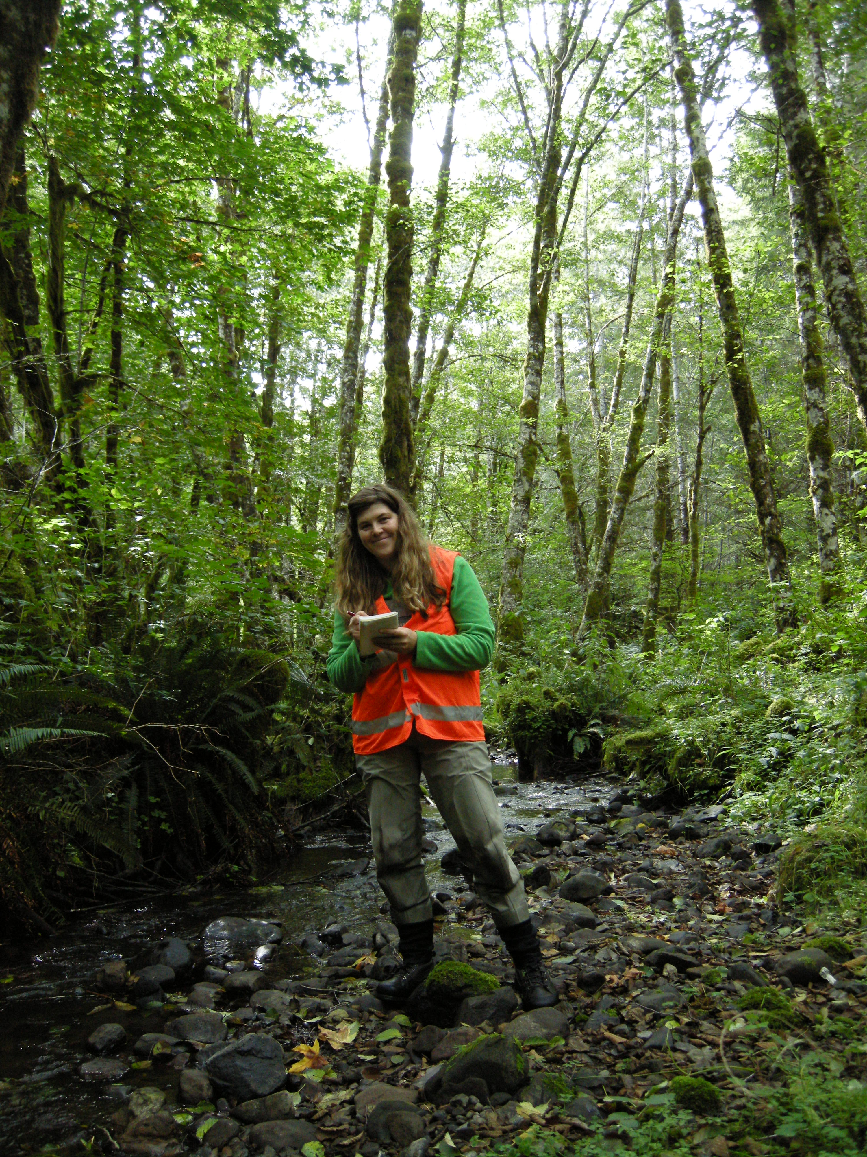 A picture of Brooke Penaluna recording habitat characteristics in Trask River watershed, Oregon Coast Range.