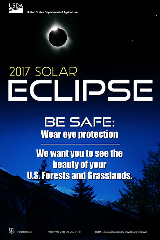 A poster that reads 2017 solar eclipse. be safe, wear eye protection, we want you to see the beauty of forests and grasslands