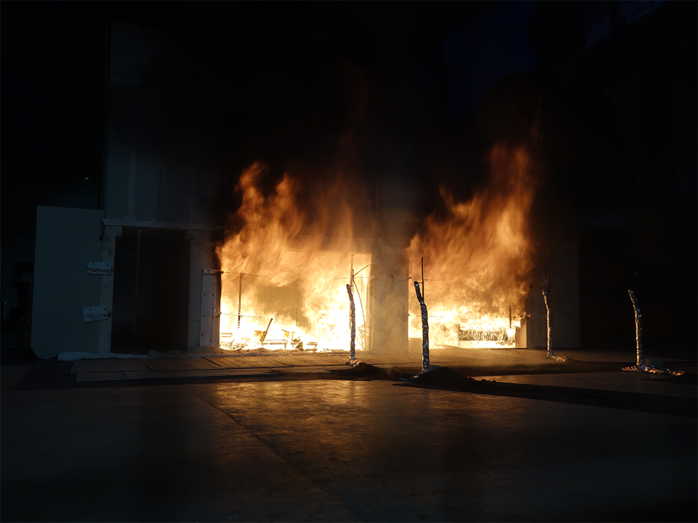 A photo of a fully engulfed cross-laminated building
