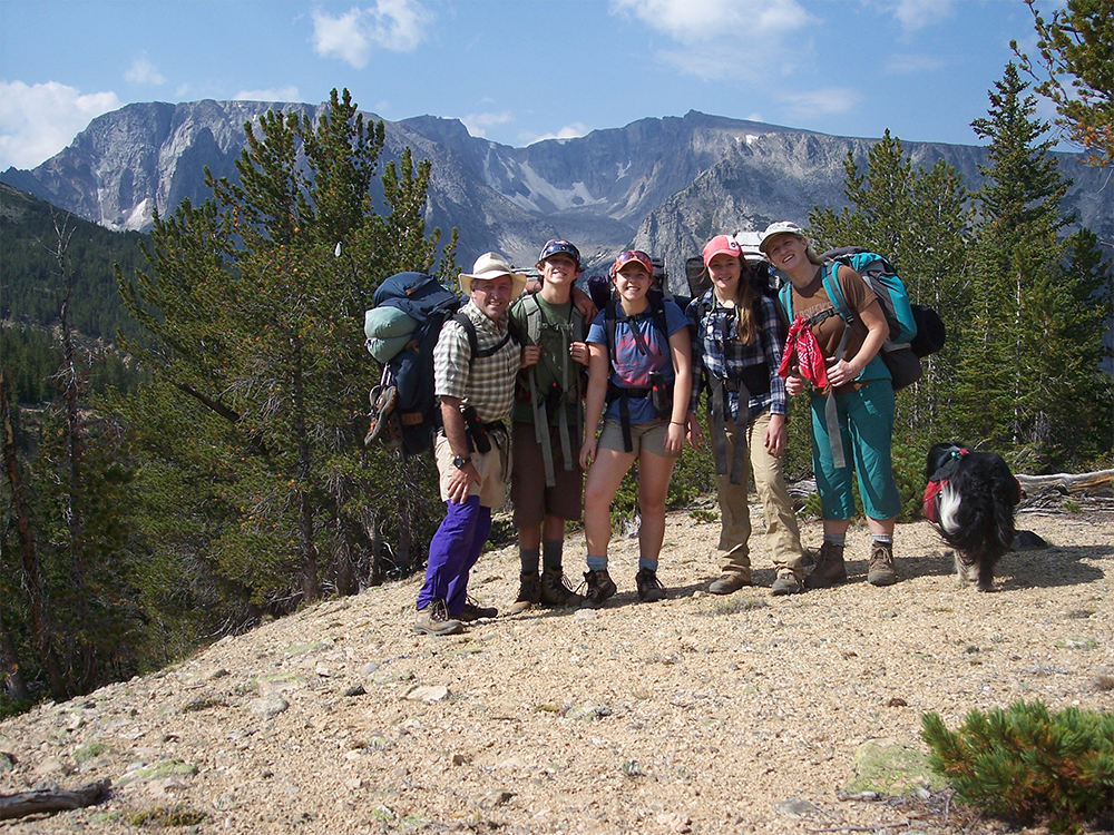 A photo of Jeff Gildehaus and his family with Red Lodge Creek Plateau, Sylvan Peak, in background