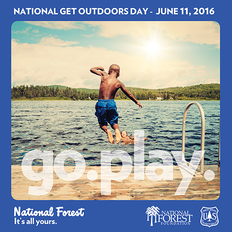A photo of a kid jumping into a lake, used for National Get Outdoors Day