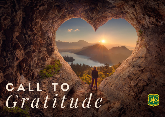 Graphic: A person looks out from a cave entrance, shaped like a heart, over public lands. Text: Call to gratitude.