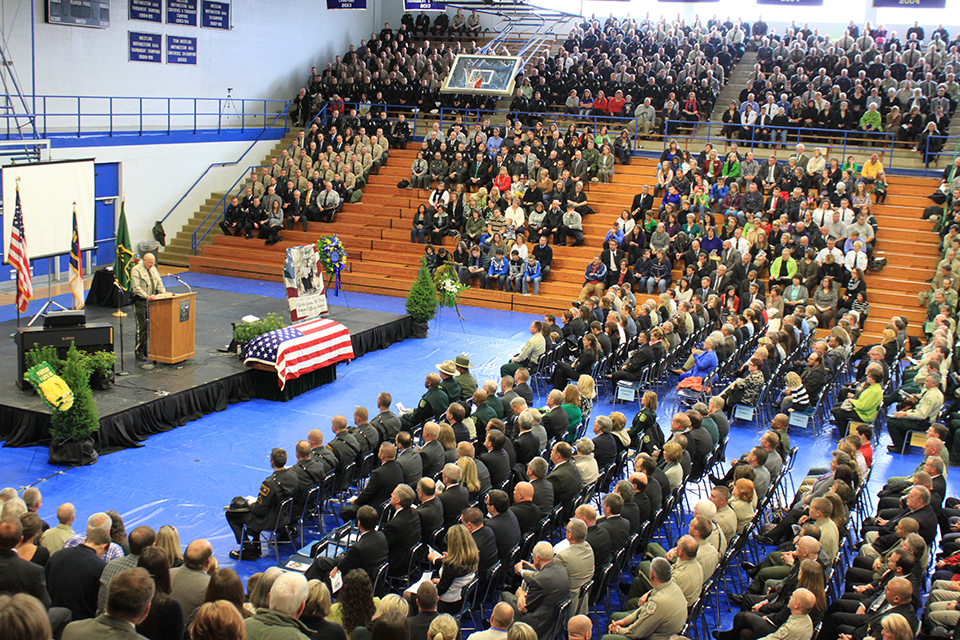 Thousands packed into the McDowell County High School to pay tribute to Forest Service Law Enforcement Officer Jason Crisp and his K-9 partner Maros.