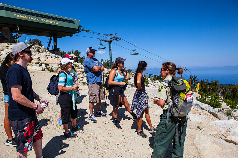 A photo of a Forest Service employee talks with a group of visitors at Heavenly Ski Resort
