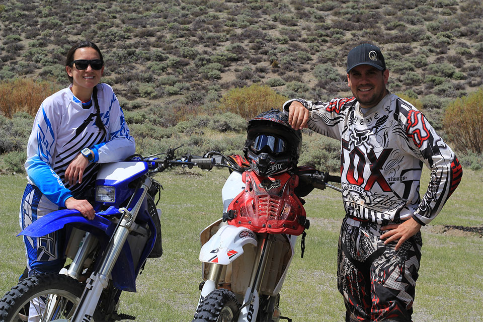 A photo of Serra Hoagland (left) stands with her dirt bike next to her older brother, David Hoagland