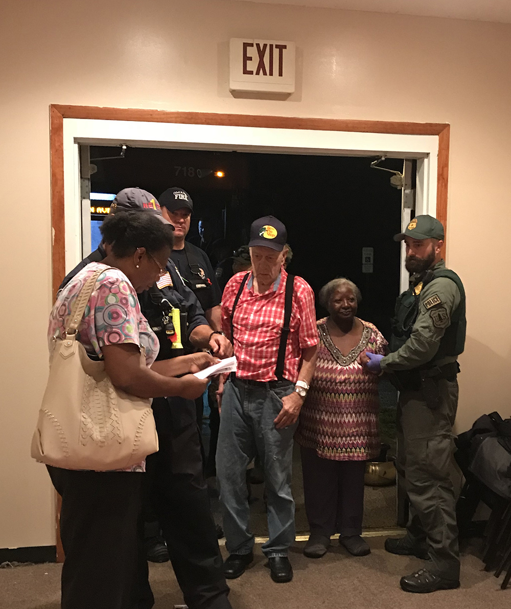 A photo of Nathan, far right, evacuating a nursing home during Hurricane Florence.