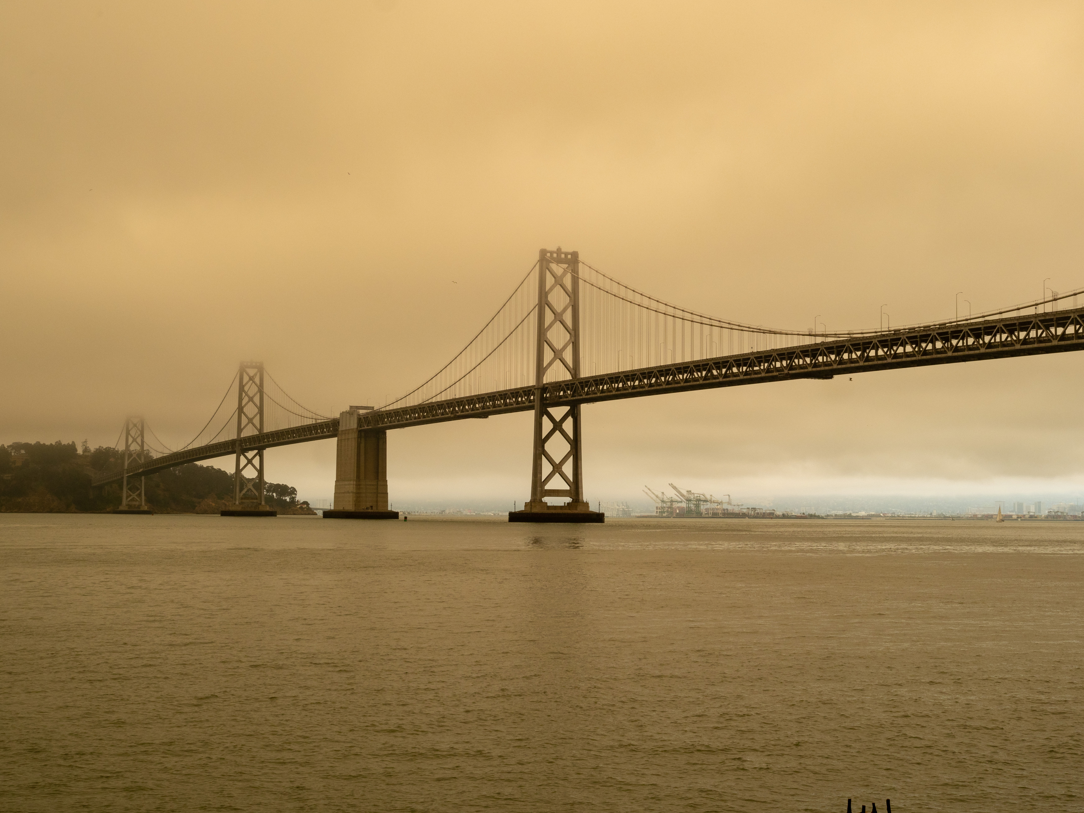 A picture of Golden Gate bridge with smoke from our nation's wildfires.