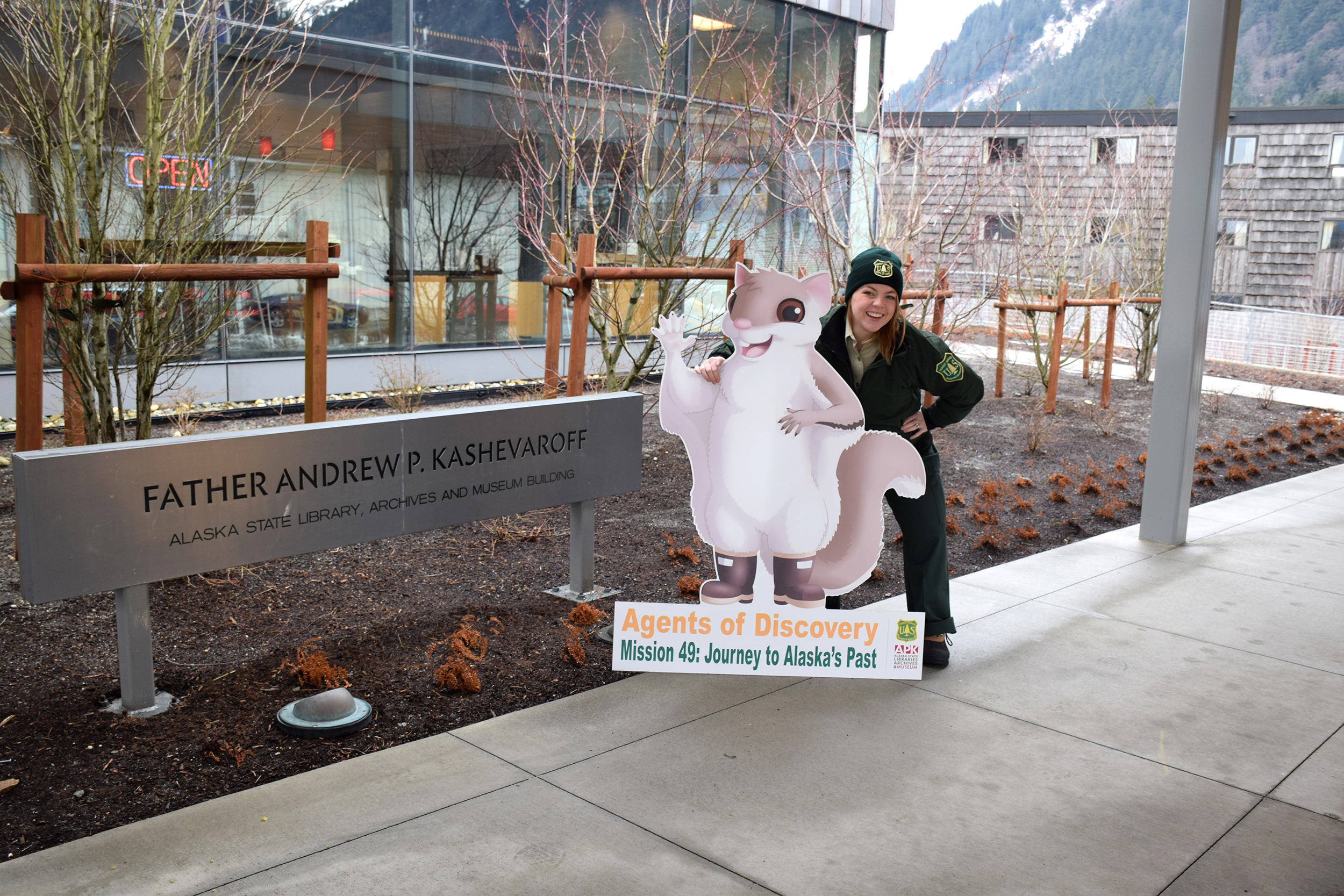 Photo: Jessi Warmbrodt poses with cardboard cut-out of northern flying squirrel.