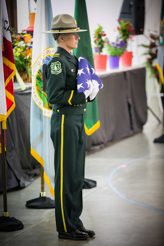 USFS Zone Fire Management Officer Jen Rabuck presents a flag during a USFS Honor Guard ceremony.  (Photo: USDA / U.S. Forest Service)